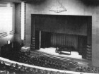 A piano concert in the original auditorium shows that the stairs had yet to be removed; a detail of the artificial skylight in the auditorium remains faithful to the original design