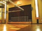 The addition of new stage lighting does not diminish the nature of the auditorium from the original design