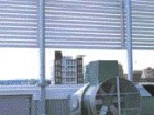 PV arrays power fans that assist in the ventilation of the building's double skin exterior wall system.