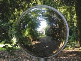 A large Gazing Globe reflects a distorted image of the picture-taker, who stands in front of the Bench pavilion