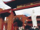 The gateway leading into Ordre bouddhique vietnamien mondial on St. Catherine Street East leads to an enormous white Buddha effigy