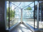 The dramatic shower relies on a distant Japanese-inspired screen for privacy