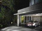 The vernacular space of the garage is finished to a high degree of detailing, in exposed concrete