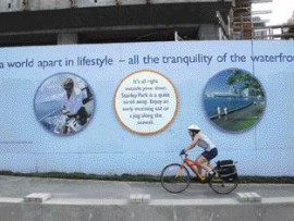 Glossy images plastered on hoarding promise a mythical and seductive life of leisure.