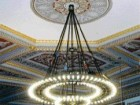 A detail image of the restored historical chandelier illustrates minimal glare on the fixture itself as well as the elimination of shadows being cast onto the ceiling.