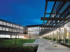 Landscaped internal courtyard spaces are formed by angled wings which radiate from the central heart of the building.