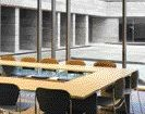 Glazed conference room permits generous amounts of daylight and views to the courtyard.