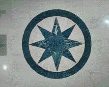 The eight-pointed black star inlaid in the Rotunda