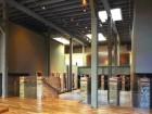 excavated brick pillars define entry into the vast sunken atrium of the gallery;