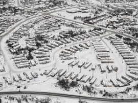 taken during the winter of 2004, this aerial photograph is meant to celebrate 18 years of collaboration between the City of Yellowknife and a major developer of mobile homes