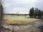 the golf course represents the extension of suburban casual living while the boreal forest landscape may still triumph over the design and landscaping of an artificial green