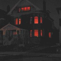 A downtown Toronto neighbourhood is entertained by the dynamic light show resulting from 35 television sets blazing inside a darkened house, evident in these three successive views of Kelly Mark's Glow House.