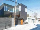 Two-storey L-shaped configuration provides ample light and views of the surrounding neighbourhood