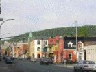 a view of Mount Royal in the distance with an established built density in the foreground.