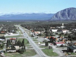 an aerial view of Haines Junction illustrates the dominant effect of the Alaska Highway.