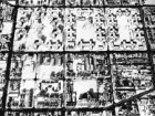 A 1957 aerial photograph shows the level of urban renewal and slum clearance, while those properties south of Dundas Street count the days before their eventual demolition.