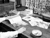 "With a copy of Sigfried Giedeon's Space, Time and Architecture on his desk and cigarette in hand, Managing Editor John Kettle looks over the layouts for a series on ""The Urban Scene"" that appeared in June, July and August of 1957."