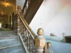 Stair Detail Reveals Vaguely Baroque Solid Wood Balustrades.