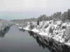 Photograph of the Forested Rocky Banks on Either Side of the French River.