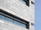 A Corner Detail of the Recessed Windows and Limestone Veneer.