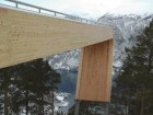 One Registers a Sense of Falling Off the Curved Edge of the Projecting Pine and Steel Structure.