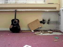 Inside An Old Music Room at St. Brides, a Burned-Out Guitar Sits Abandoned as the Building Awaits Demolition.