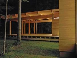 Viewed at Night, the Transparency of the Minimal Retreat Allows the House's Timber Frame to Complement the Nature of the Visual Field Afforded by the Surrounding Wood.