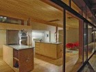 A View Into the Kitchen Through the Window Wall Illustrates the Ambiguity Between Interior and Exterior Spaces.