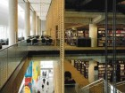 Photograph Captures the Sectional Dynamic of the Library; the Wood Screen Separates the Open Public Space of the Concourse From the More Private Enclosed Zones of the Reading and Research Areas.