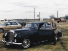 Wiens Pictured With His Prized Early-Model Bentley Against the Vast Prairie Sky.