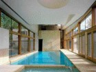 In the Subtly Curved Spa Wing, the Swimming Pool Is Positioned Between Two Distinct Landscapes.