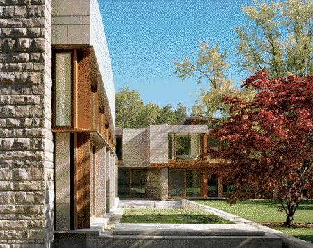 A Curved Limestone Wall Gently Arcs Back Toward the Juncture of the House, Where the Second-Floor Master Suite Lies Atop the Ground-Floor Kitchen.
