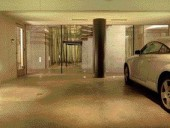 Parking at a Premium: Seen From the Lower Floor (Plan Not Shown), the Garage Appears to Blend Seamlessly Into the Entry Foyer and Sunken Garden Beyond.
