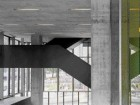 Abstract Form of the Black Steel Staircase Scissors Into the Atrium Space of the Lobby.