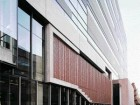 The School's Eastern Facade Incorporates Limestone, Horizontally Striated Zinc and Clay Brick.