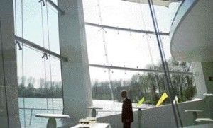 Inside Asymptote's Hydra Pier, Two of the Three Wrap-Around Windows Frame the Untouchable Dutch Landscape Beyond.