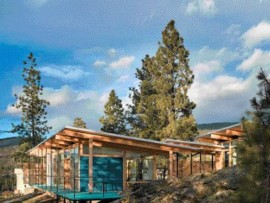Wooden Pavilion Forms of the Maurer House Emerge From the Bedrock of the BC Interior.