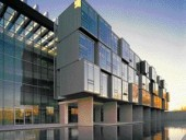 Forty-Four Stacked Cantilevered Boxes Containing Researchers' Offices Comprise the North Elevation Overlooking a Reflecting Pool.