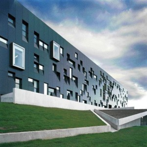 Dramatic South Elevation of Mirror-Framed Windows and Anodized Aluminum Panels Is Designed to Mimic the Experience One Might Have When Confronting Esoteric Scientific Discourse.