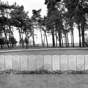 Gravestones of Fallen Soldiers Along Givenchy Road Create a Somber Landscape Punctuated by An Allee of Trees in the Background.