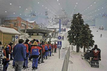 Skiers Line Up for the Chair Lifts Within the Vast Climate-Controlled Theme-Park Environment of This Facility.