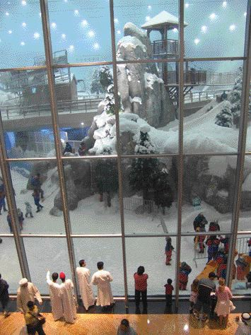 Visitors Observe the Activity in This Desert Winter Wonderland--Man-Made Snow Frosts the Entirely Man-Made Structures Contained Within Ski Dubai.