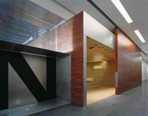 Three Interior Views of the Farmington Hills Facility Reveal a Sculptural Sensibility in the Vaguely Abstract Planes and Volumes of Contrasting Materiality.