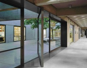 Large Pivoting Panes of Glass Seamlessly Open Up the Building's Interior to the Exterior.