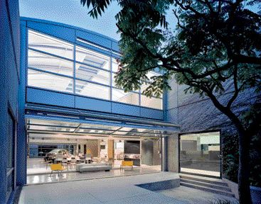 Another Courtyard Extends the Studio Space Through An Expansive Glass Garage Door.