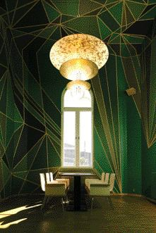 In the Restaurant, Cardiac Arrest-Inducing Shades of Chartreuse and Emerald Form a Jagged Mural Entitled Earth Minor Major in Yellow and Green, Courtesy of Artist Chris Ofili.