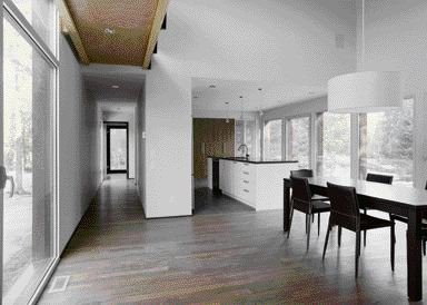 A View Down the Length of the Home Demonstrates the Spartan Qualities of the Home's Design.