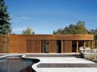 Sliding Doors Create a Constantly Changing Facade Along the West Elevation.