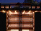 At Night, the Sapele Wood Screening Creates the Effect of a Nearly Transparent Lantern, Casting a Warm Glow by the Pool.