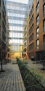 Between the Two Buildings and Protected at Each End by Glass Walkways, the Internal Courtyard Serves as a Gathering Place for the Residents.